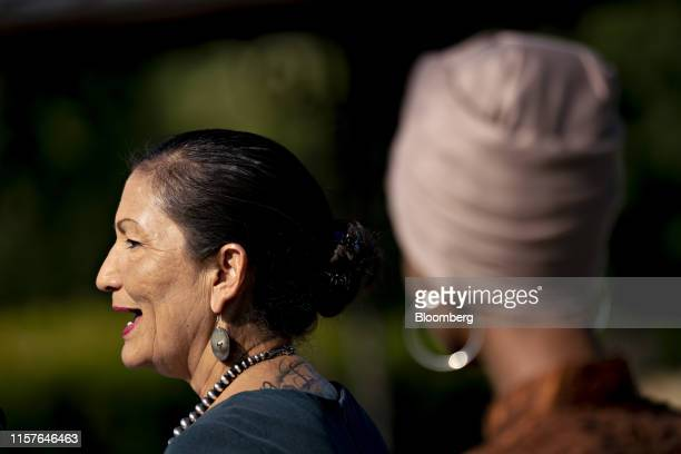 Representative Deb Haaland a Democrat from New Mexico speaks as Representative Ilhan Omar a Democrat from Minnesota right listens during a news...
