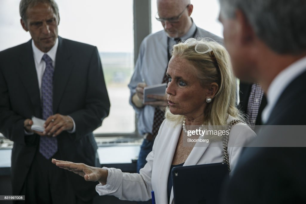Representative Debbie Dingell, a Democrat from Michigan, center, speaks while visiting the American Mobility Center (ACM) in Ypsilanti, Michigan, U.S., on Tuesday, Aug. 15, 2017. Representative Dingell and Representative Bob Latta, a Republican from Ohio, visited the ACM to meet with experts in the autonomous vehicles industry as the two work together to advance bipartisan self-driving vehicle legislation through the House floor. Photographer: Sean Proctor/Bloomberg via Getty Images