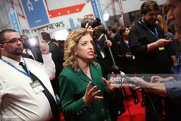 S Representative Debbie Wasserman Schultz and chair of the Democratic National Committee speaks to reporters in the spin room after watching...