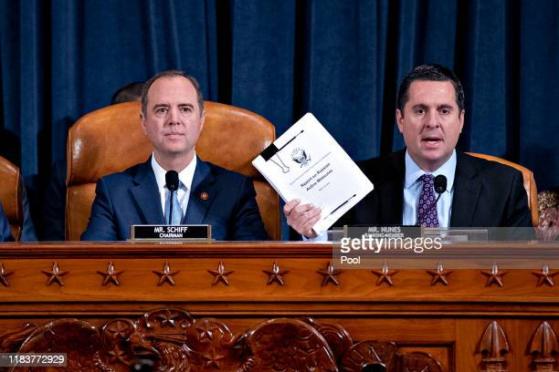 Representative Devin Nunes a Republican from California and ranking member of the House Intelligence Committee right speaks as Representative Adam...