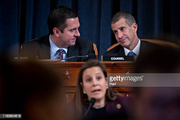 Representative Devin Nunes, a Republican from California and ranking member of the House Intelligence Committee, top left, talks to Steve Castor,...