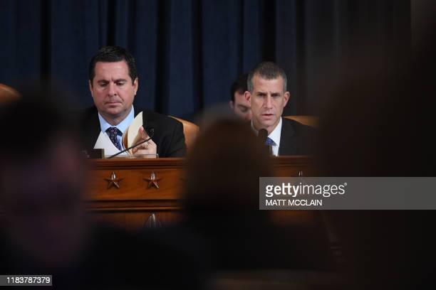 Representative Devin Nunes looks on as counsel Steve Castor asks questions as Fiona Hill the former top Russia expert on the National Security...