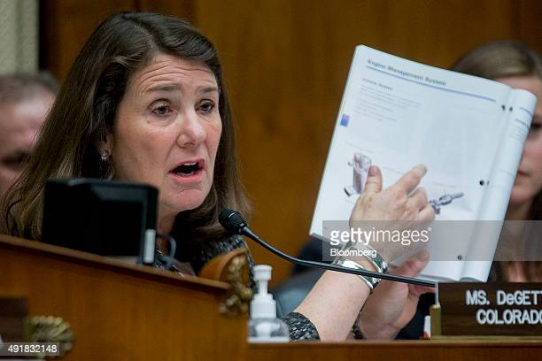 Representative Diana DeGette a Democrat from Colorado holds up an Volkswagen exhaust system page as she questions Michael Horn president and chief...