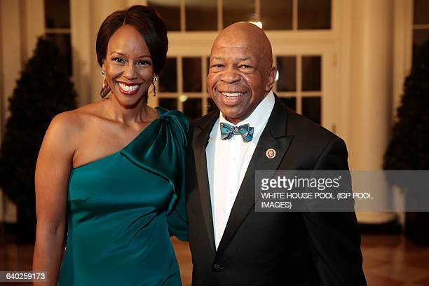 Representative Elijah Cummings a Democrat from Maryland right and Maya Rockeymoore Cummings arrive to a state dinner hosted by US President Barack...