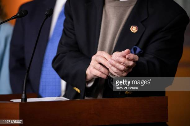 Representative Eliot Engel points to where he saw where Holocaust Survivors had their prison camp numbers tattooed on their arms as he speaks about a...