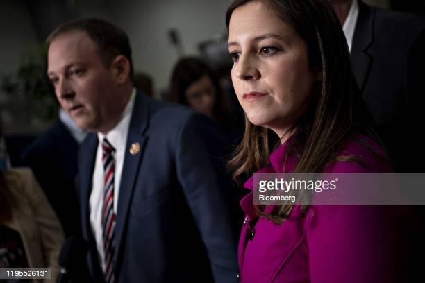 Representative Elise Stefanik, a Republican from New York, listens as Representative Lee Zeldin, a Republican from New York, left, speaks to members...