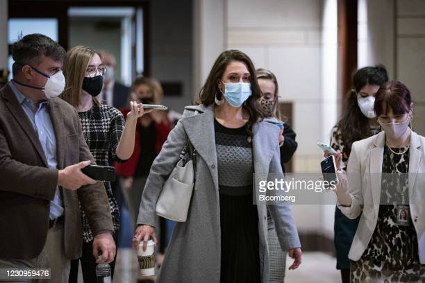Representative Elise Stefanik, a Republican from New York, wears a protective mask as she arrives for a House Republican caucus meeting on Capitol...