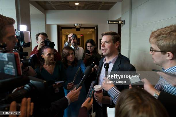 S Representative Eric Swalwell speaks to reporters as he arrives to the Capitol for a closed door deposition with Mark Sandy a senior career official...