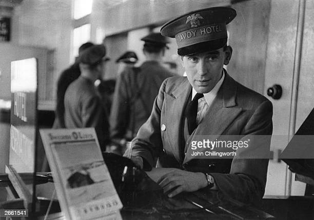 A representative from the Savoy Hotel waits to greet guests at London airport Original Publication Picture Post 5209 Round the Clock at London...