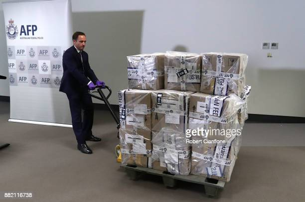 A representative from the Victorian Joint Organised Crime Taskforce wheels in 300kg of cocaine at the Australian Federal Police Melbourne office on...