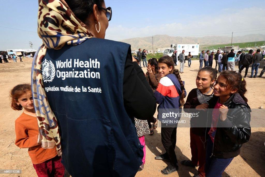 A representative from the world health organization speaks with a representative from the world health organization speaks with displaced iraqi children in bajid kandala camp publicscrutiny Gallery