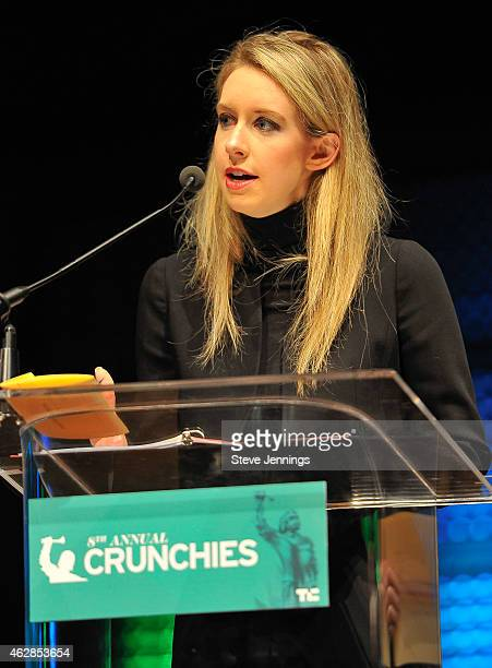 Representative from Theranos, winner of Best Health Startup, collects their award at the TechCrunch 8th Annual Crunchies Awards at the Davies...