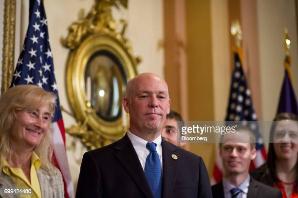 Representative Greg Gianforte a Republican from Montana center stands during a swearing in ceremony in Washington DC US on Wednesday June 21 2017...