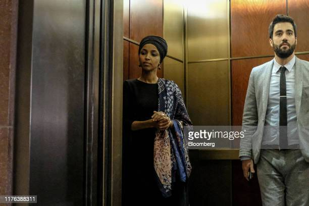 Representative Ilhan Omar a Democrat from Minnesota left gets into an elevator during a closeddoor testimony before House committees with Gordon...