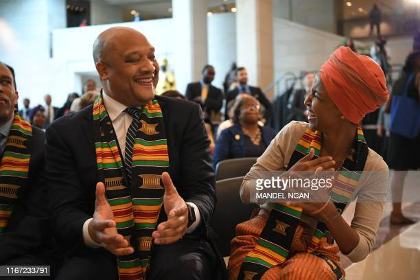 US Representative Ilhan Omar and André Carson arrive for the Congressional Black Caucus ceremony to commemorate the 400th anniversary of the first...