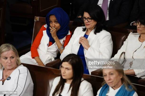 Representative Ilhan Omar and Rep Rashida Tlaib react during the State of the Union address before members of Congress in the House chamber of the US...
