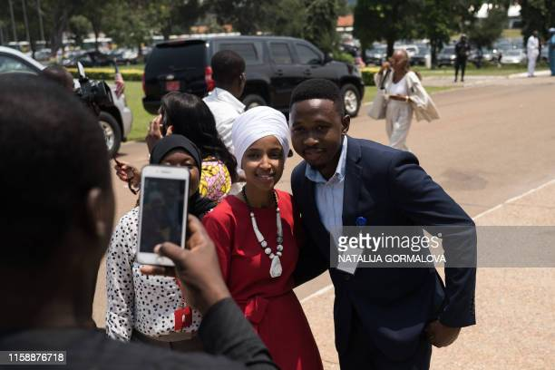 Representative Ilhan Omar poses for pcitures as she arrives at the Ghana's Parliament in Accra on July 31 2019 during a threeday visit to the country...