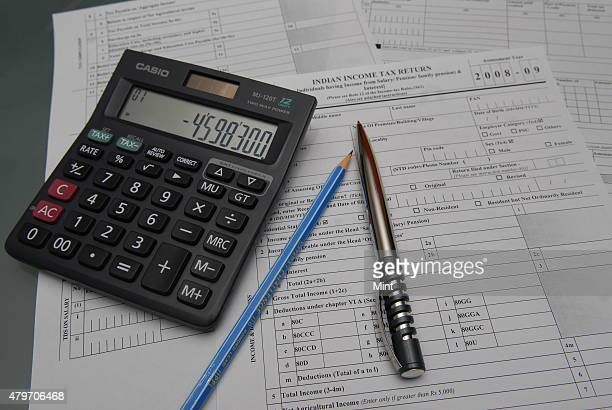 A representative image of Indian Income Tax Return Form with calculator and a pen on June 24 2009 in New Delhi India