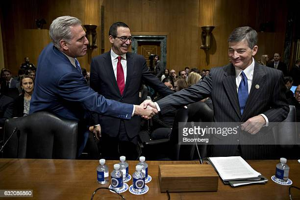 Representative Jeb Hensarling a Republican from Texas and chairman of the House Financial Services Committee right shakes hands with House Majority...