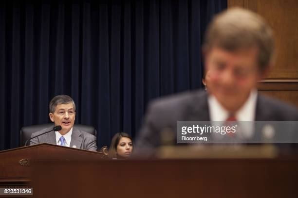 Representative Jeb Hensarling a Republican from Texas and chairman of the House Financial Services Committee left speaks during a hearing on Capitol...