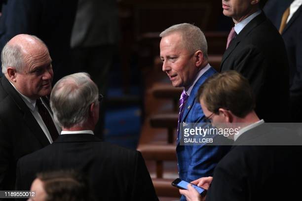Representative Jeff Van Drew chats with collegues as US Speaker of the House Nancy Pelosi presides over Resolution 755 Articles of Impeachment...