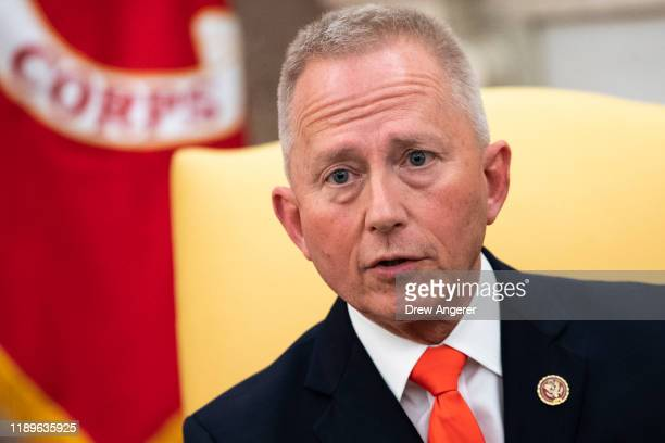 US Representative Jeff Van Drew of New Jersey who has announced he is switching from the Democratic to Republican Party speaks to the press as he...