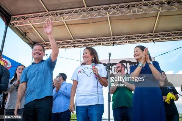 Representative Jesus Garcia a Democrat from Illinois waves as Representative Veronica Escobar a Democrat from Texas center and Representative Deb...