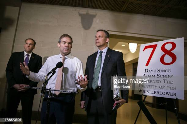 Representative Jim Jordan a Republican from Ohio center speaks to members of the media while Alexander Vindman director for European affairs on the...