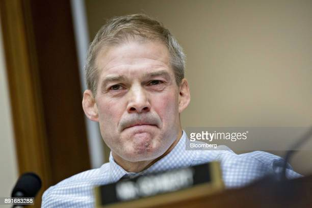 Representative Jim Jordan a Republican from Ohio listens as Rod Rosenstein deputy attorney general not pictured responds to his question during a...