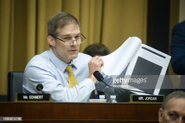 Representative Jim Jordan a Republican from Ohio shows redacted memos from the Department of Justice while speaking during a hearing with Matthew...