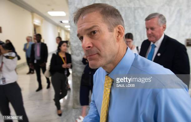 US Representative Jim Jordan Republican of Ohio and US Representative Mark Meadows Republican of North Carolina leave after US Acting Secretary of...