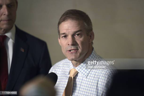 US Representative Jim Jordan Republican of Ohio speaks to reporters during a closeddoor congressional meeting by former aide Fiona Hill before...