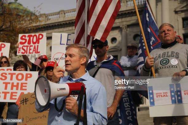 Representative Jim Jordan stands with dozens of people calling for stopping the vote count in Pennsylvania due to alleged fraud against President...