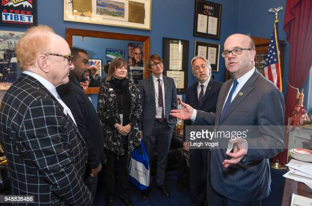 S Representative Jim McGovern speaks with producer and musician Peter Asher along with Rodney Jerkins Christine Albert Justin Roberts and Neil...