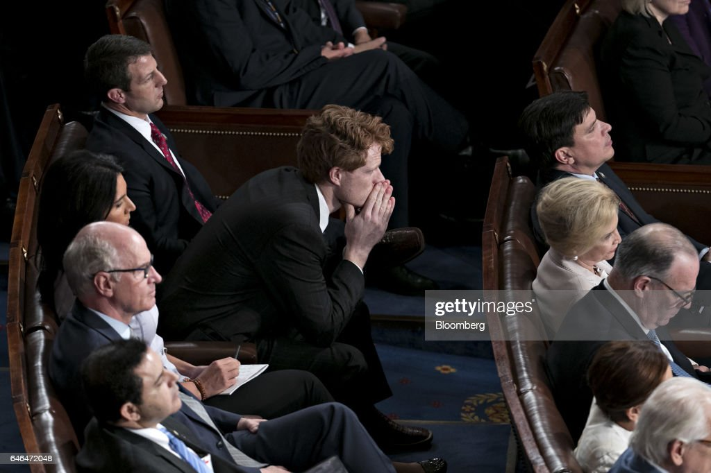 Representative Joe Kennedy, a Democrat from Massachusetts, center, listens as U.S. President Donald Trump, not pictured, speaks during a joint session of Congress in Washington, D.C., U.S., on Tuesday, Feb. 28, 2017. Trump will press Congress to carry out his priorities for replacing Obamacare, jump-starting the economy and bolstering the nations defenses in an address eagerly awaited by lawmakers, investors and the public who want greater clarity on his policy agenda. Photographer: Andrew Harrer/Bloomberg via Getty Images