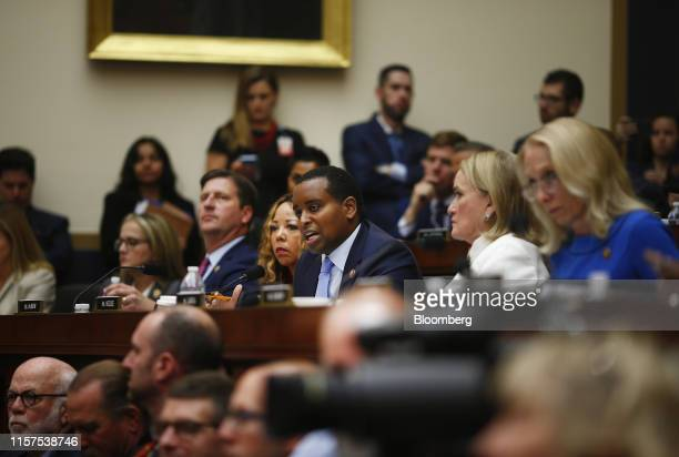 Representative Joe Neguse a Democrat from Colorado center questions Robert Mueller former special counsel for the US Department of Justice during a...