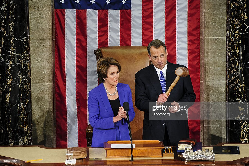 Representative John Boehner, a Republican from Ohio, holds the gavel after receiving it from House Minority Leader Nancy Pelosi, a Democrat from California, left, after Boehner was elected to a second term as Speaker of the House at the U.S. Capitol in Washington, D.C., U.S., on Thursday, Jan. 3, 2013. The 113th Congress convenes today in Washington where new members will try to meld their diverse backgrounds in a legislature containing a record seven openly gay lawmakers, an unprecedented 20 women in the Senate and the first all-female state delegation, from New Hampshire. Photographer: Pete Marovich/Bloomberg via Getty Images