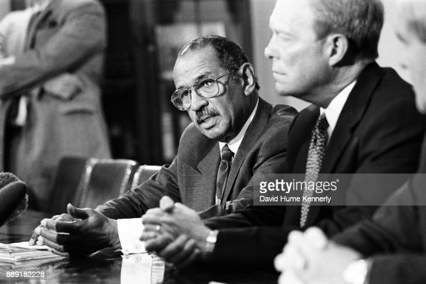 Representative John Conyers and House Minority Leader Richard Gephardt at a news conference in Gingrich's office to discuss the Starr Report issued...