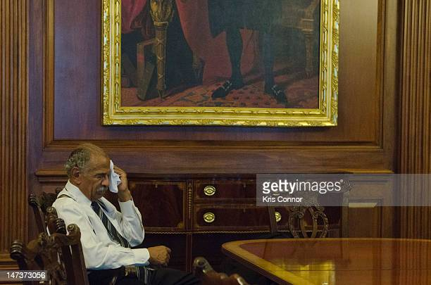 Representative John Conyers sits the House chambers before a vote on the 2nd part of the US House of Representatives vote to hold Attorny General...