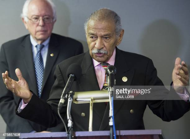 US Representative John Conyers speaks alongside Democratic Presidential Hopeful Senator Bernie Sanders about the introduction of a bill 'Employ Young...