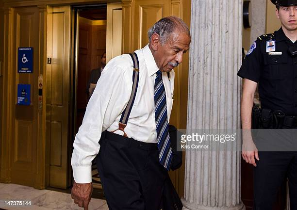 Representative John Conyers walks into the House chambers to vote on the 2nd part of the US House of Representatives vote to hold Attorny General...