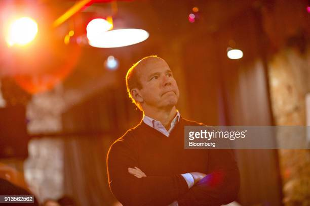 Representative John Delaney a Democrat from Maryland and 2020 presidential candidate center listens as Abby Finkenauer a current Iowa State...