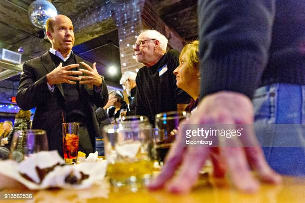 Representative John Delaney a Democrat from Maryland and 2020 presidential candidate left speaks to attendees during a fundraiser for Abby Finkenauer...
