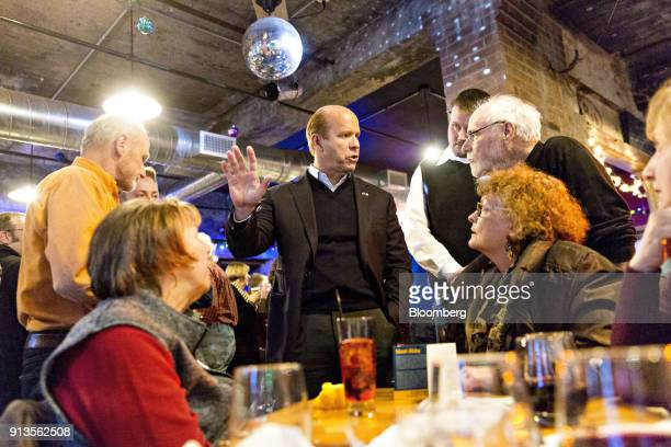 Representative John Delaney a Democrat from Maryland and 2020 presidential candidate center speaks to attendees during a fundraiser for Abby...