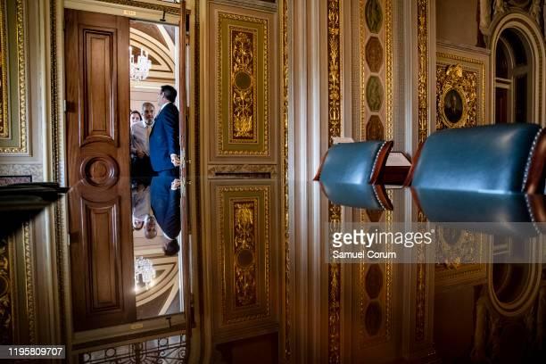 Representative John Ratcliffe holds open the door for Representative Jim Jordan as President Donald Trumps defense team leaves their meeting room to...