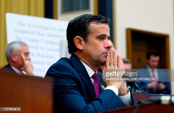 US Representative John Ratcliffe Republican of Texas listens as former Special Counsel Robert Mueller testifies in Washington DC on July 24 2019