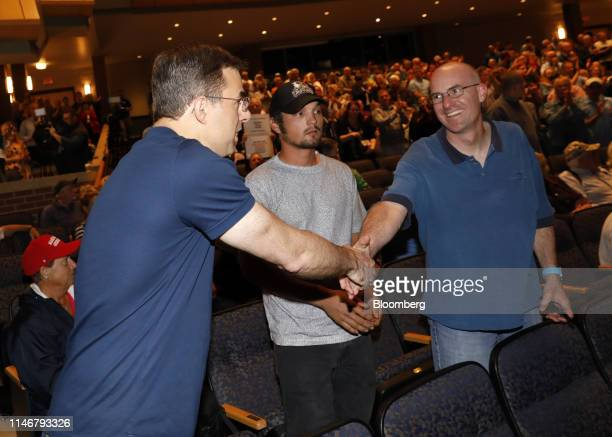 Representative Justin Amash, a Republican from Michigan, left, shakes hands with an attendee before a town hall event in Grand Rapids, Michigan,...