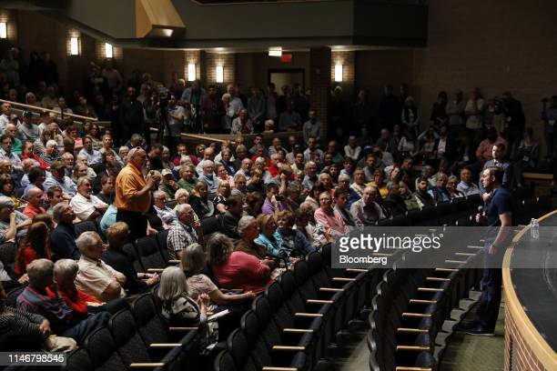 Representative Justin Amash, a Republican from Michigan, right, listens to a question from an attendee during a town hall event in Grand Rapids,...