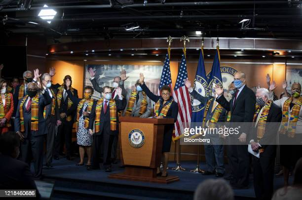 Representative Karen Bass, a Democrat from California and chair of the Democratic Black Caucus, and House and Senate Democrats raise their hands when...