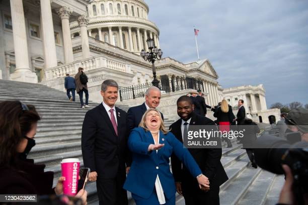 Representative Kat Cammack , Republican of Florida, laughs as she takes photographs with fellow first-term Republican members of Congress on the...